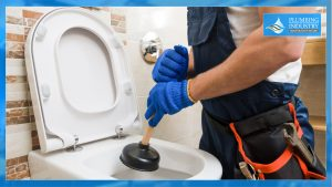 Plumber holding a Toilet plunger